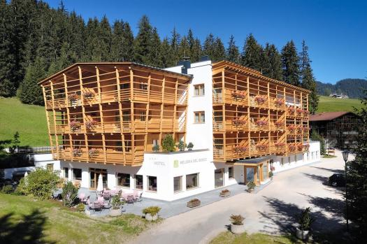 Exterior of the Hotel Melodia del Bosco. Book your stay at the Melodia del Bosco here. Planning your summer in the mountains of Alta Badia.
