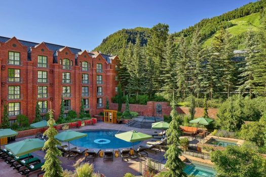 The outside of the pool at the St Regis in Aspen. Book your stay at the St Regis here. Aspen Snowmass is opening for the Summer Season.