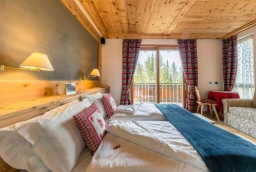 A double room at La Locanda del Cantoniere. Book your stay at La Locanda del Cantoniere here. Cortina d'Ampezzo is ready for a new summer season.
