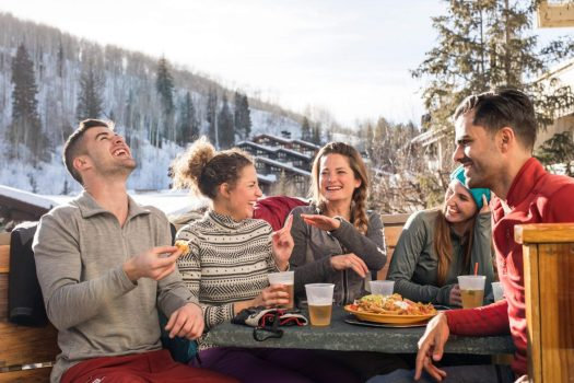 Some friends enjoy après after skiing in Vail, CO. Photo: Craig Orsini. Vail Resorts. The Must-Read Guide to Vail.