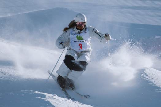 Photo: Olympic Winter Institute Australia. Bump skier. To extend or not to extend… that is the question.