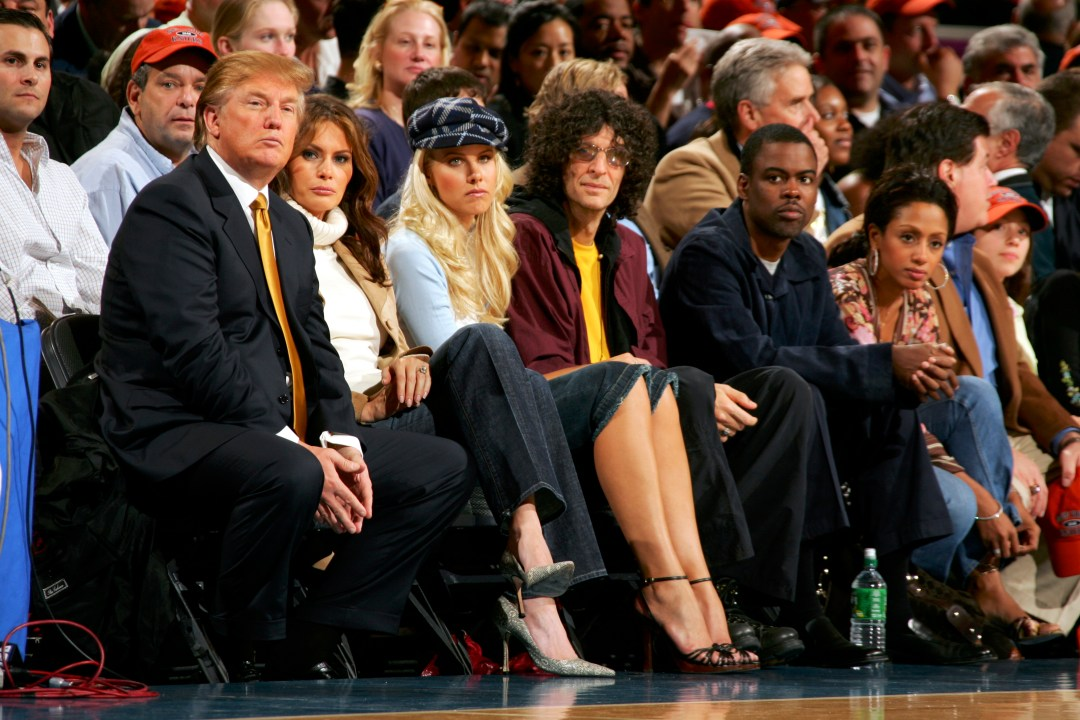 Donald Trump, left, is seated with Melania Trump, Howard Stern and and his girlfriend Beth Ostrosky at Madison Square Garden in 2005