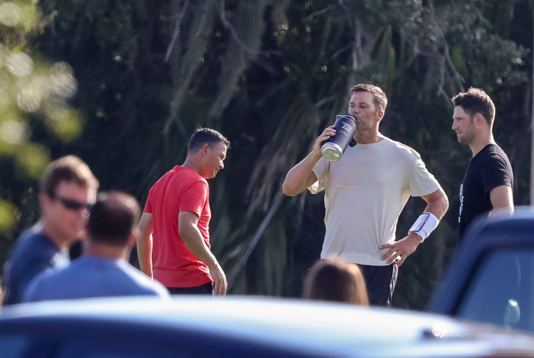 Brady and his teammates were spotted practicing together without masks