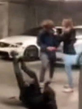 A man was seen on the ground as a scuffle happened off-camera