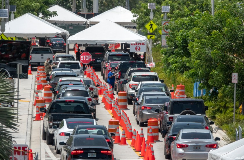 cars waiting in line for coronavirus test