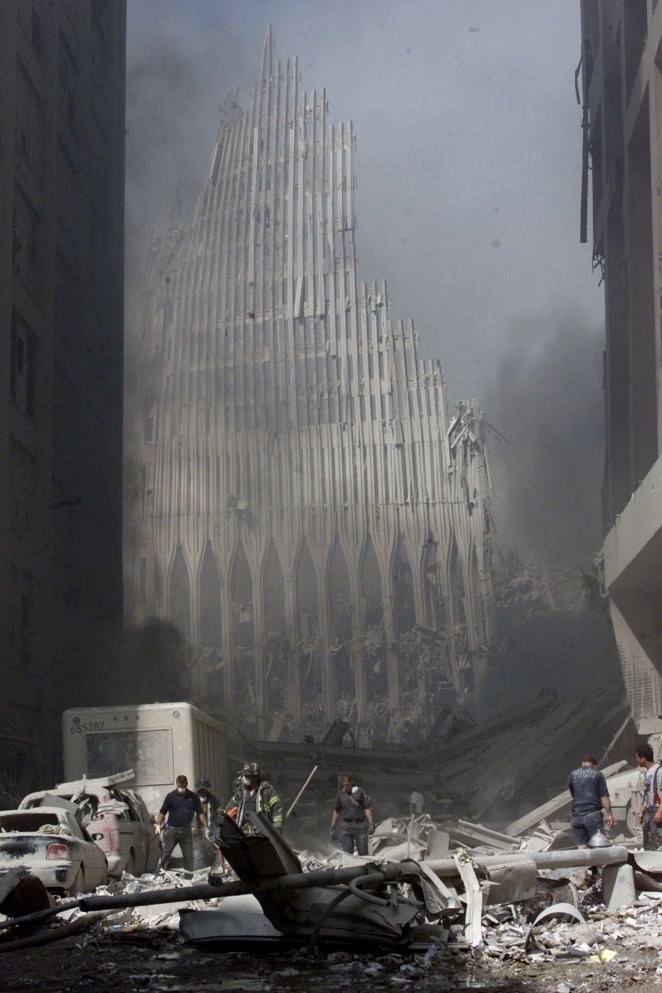 Firemen work near the base of the destroyed World Trade Center