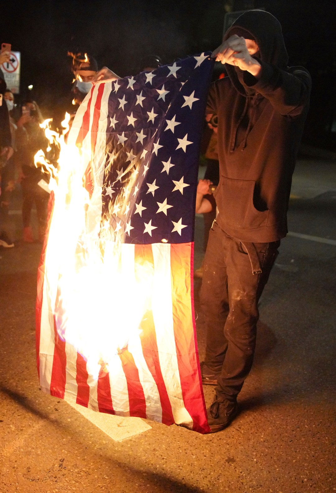 Protesters burn an American flag in Portland, Oregon, last September