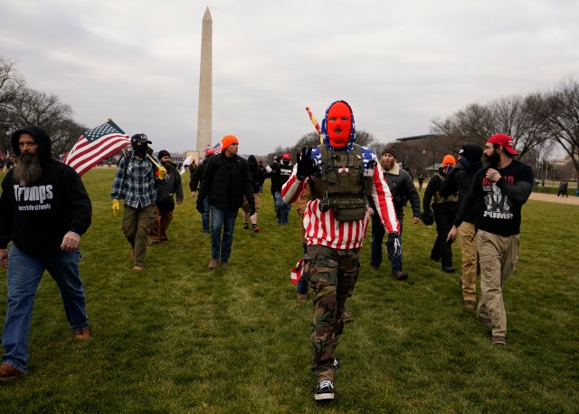 People claiming to be members of the far-right Proud Boys are seen marching near the White House ahead of Trump's speech
