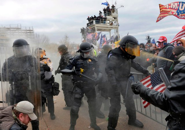 Trump supporters clash with police and security forces in DC on January 6