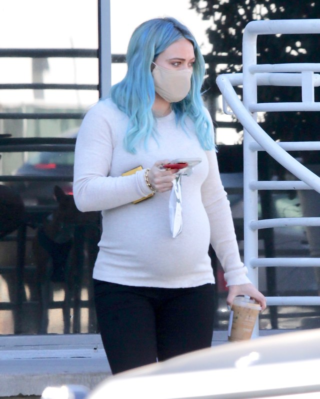 Hilary Duff showed off her growing baby bump while out on a coffee run