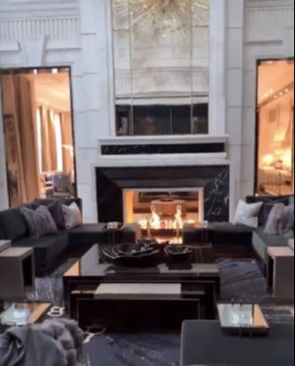 The cozy fireplace is surrounded by a handful of sofas