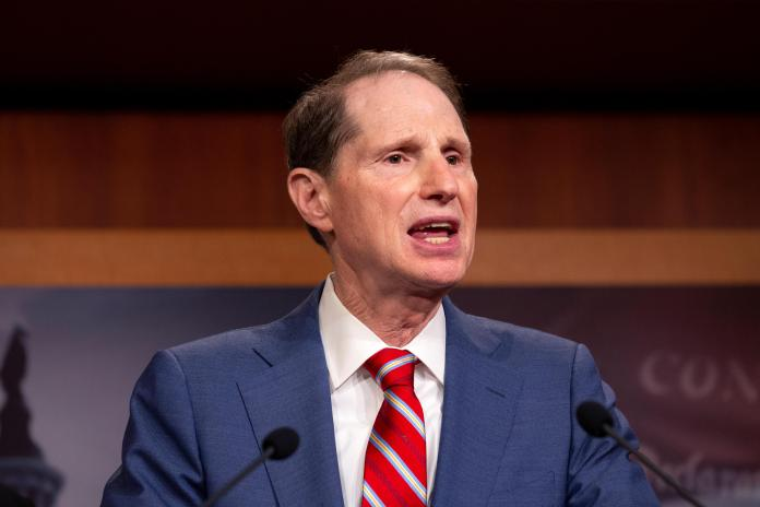Twenty-one Senate Democrats. including Senate Finance Committee Chairman Ron Wyden, have called on President Joe Biden to include recurring stimulus payments into his future COVID recovery plans