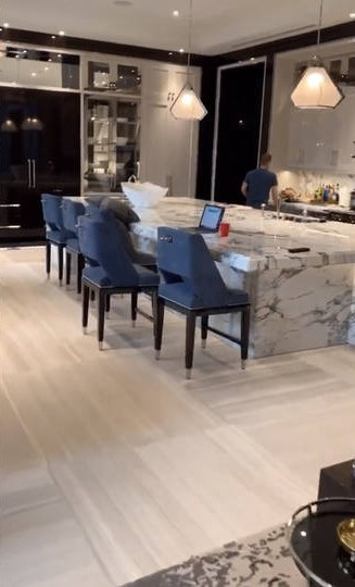 Drake's gourmet kitchen has a large marble island