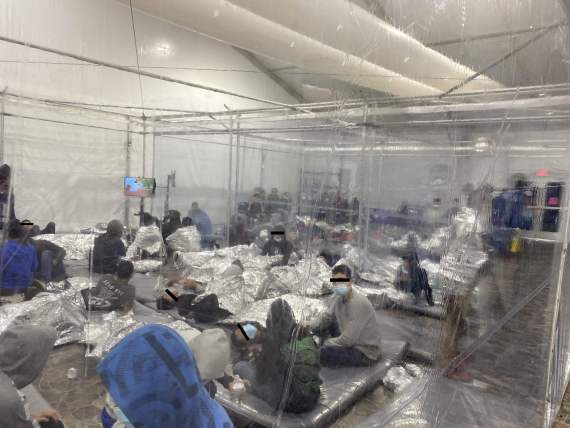 Migrants inside a temporary overflow facility in Donna, Texas