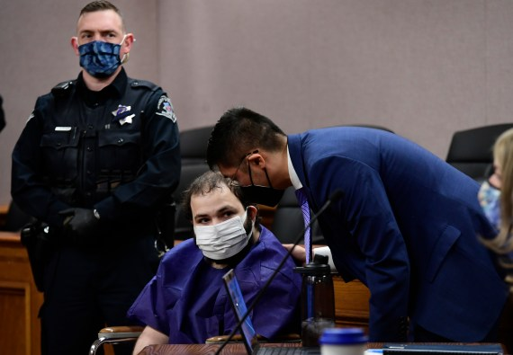 The suspected shooter has appeared in a wheelchair in court and has been held without bail