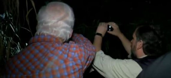 Cruz is seen in the above images taking photographs of what he claims were human traffickers
