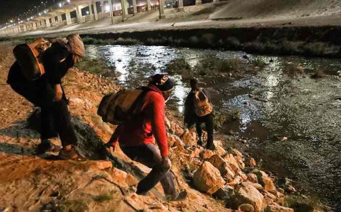 Migrants attempt to cross Rio Bravo to get into El Paso in Texas on March 30