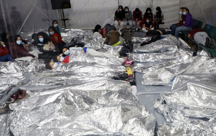 Images surfaced earlier this week showing unaccompanied children living in cramp conditions in a migrant camp in Donna, Texas (above)