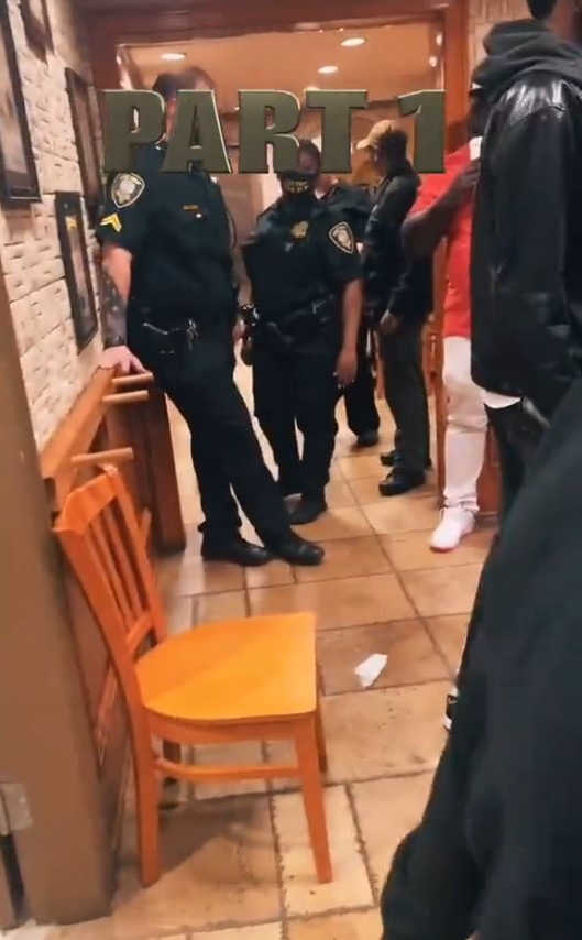 One male officer appeared to be amused by the unfolding events