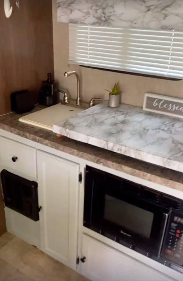 She added marble to the kitchen and painted the cabinets