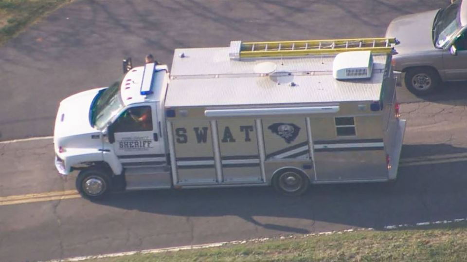 A SWAT team was pictured on site