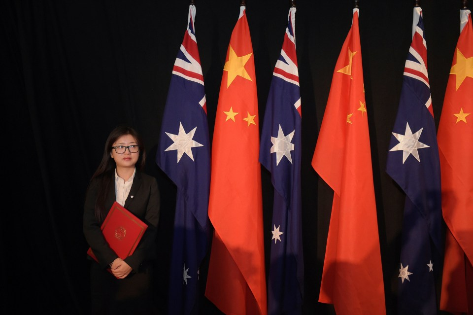 China's mouthpiece has issued a fresh attack on Australia - with the publication of a propaganda poster taking aim at Australian troops