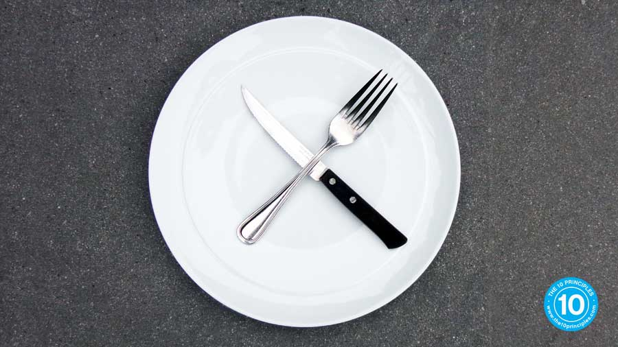 EMPTY plate with a knife and fork beside it