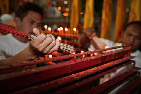 Phuket Vegetarian Festival - lighting incense.