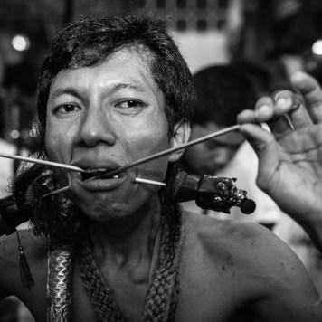 cheeks pierced phuket vegetarian festival