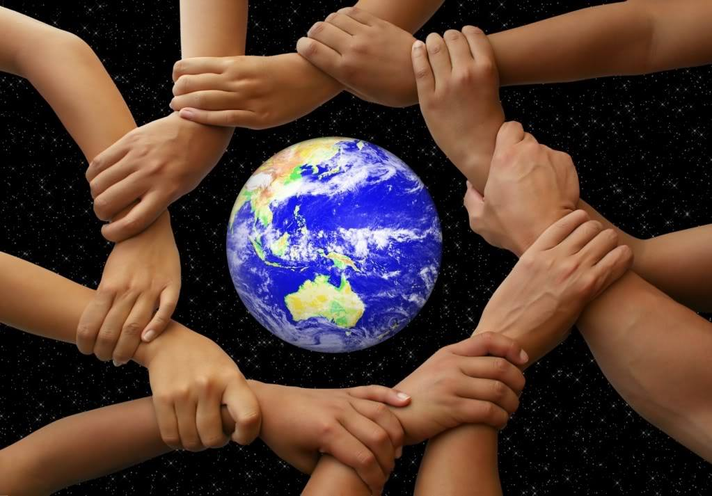 circle of linked hands around a globe