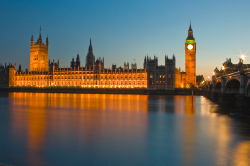 View across the River Thames of the Houses of Parliament at night