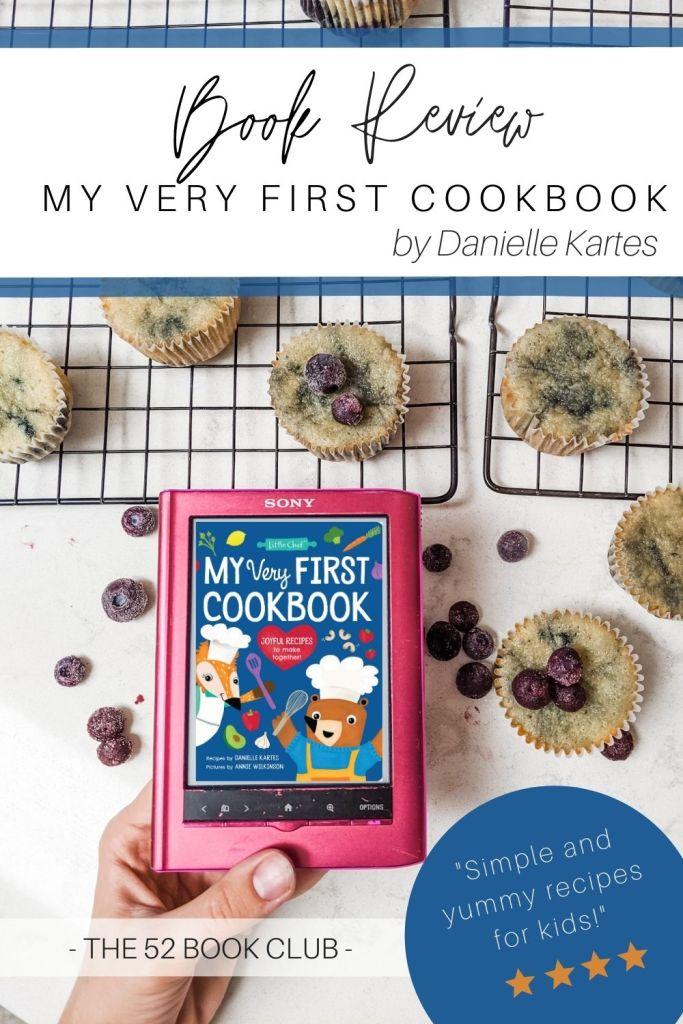 My Very First Cookbook on an e-reader set amongst blueberry muffins