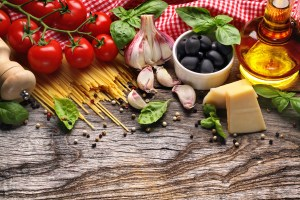 Italian food ingredients on wooden background (dollarphotoclub)