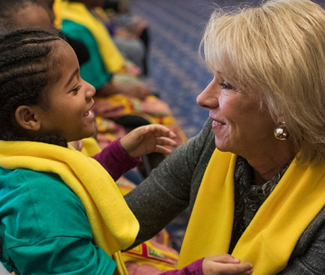 Education Secretary Betsy Devos Greets Arielle Jordan 6 Of The Districts Kuumba Preparatory School Of The Arts During A Rally As Part Of National School