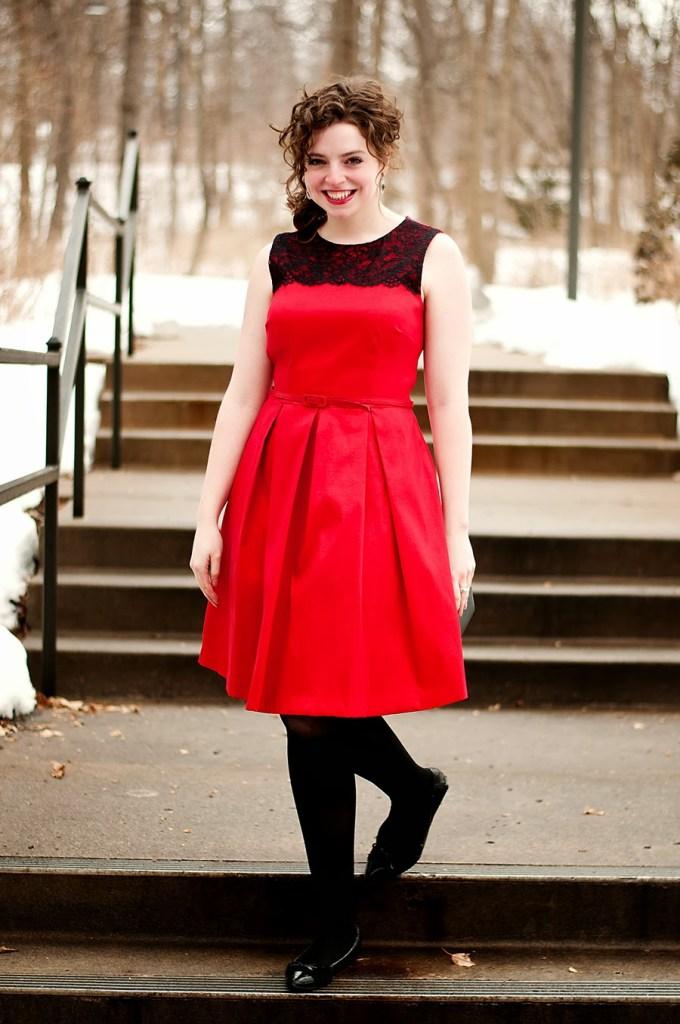 Red and black sleeveless lace dress