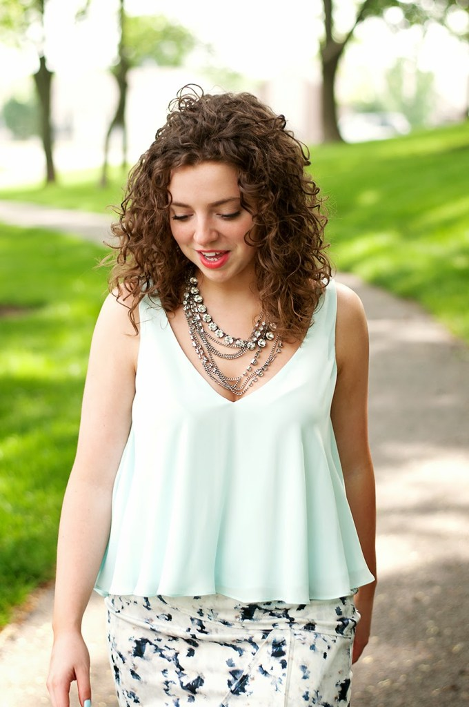 Light blue blouse with layered statement necklace