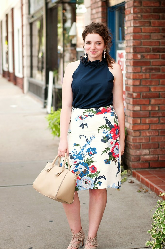 Floral skirt with ruffled blouse and lace up heels
