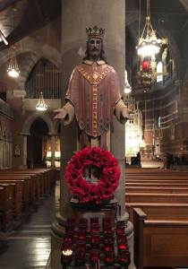 wreath of poppies at the shrine of Christ the King in the nave