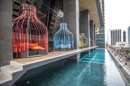 Infinity Pool with Bird Cage Lounges at I'M Hotel Manilla, Philippines. Learn how to save money online using Ebates.