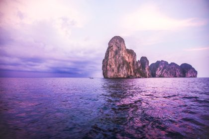 A gorgeous purple sunset from a boat in the ocean off the coast of Koh Phi Phi, Thailand.