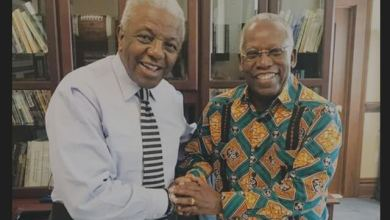 Author Kojo Yankah (right) with Livingstone College President Jimmie R. Jenkins