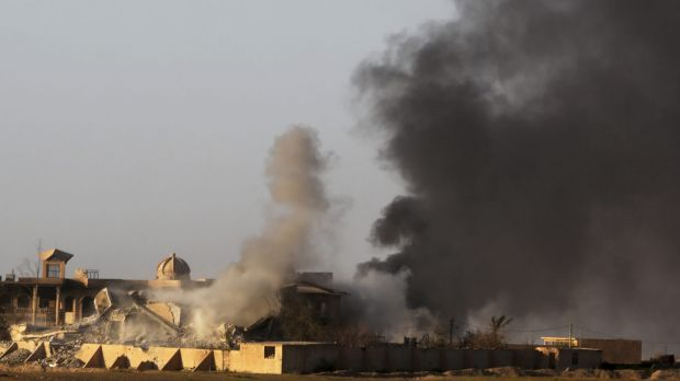 Smoke rises from buildings in Tikrit during clashes between Iraqi security forces and Islamic State militants on Thursday.