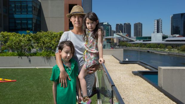 Denise Fung-Henderson, with children Will, 8, and Poppy, 6, is campaigning for a school in the Docklands.