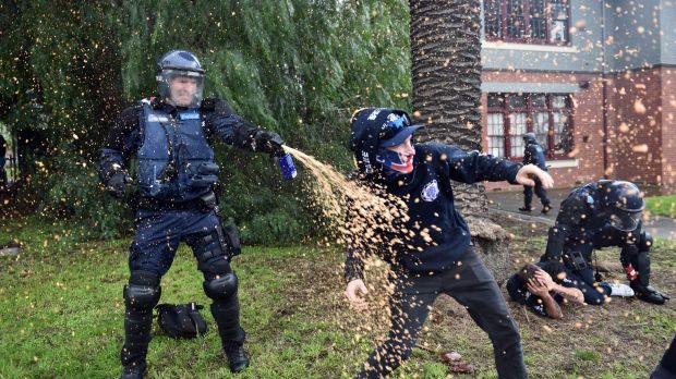 Police deploy capsicum spray as anti-immigration and anti-racism protesters clash in Coburg.