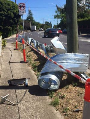 Safety barrier taken out by trucks travelling on Rosanna Road.