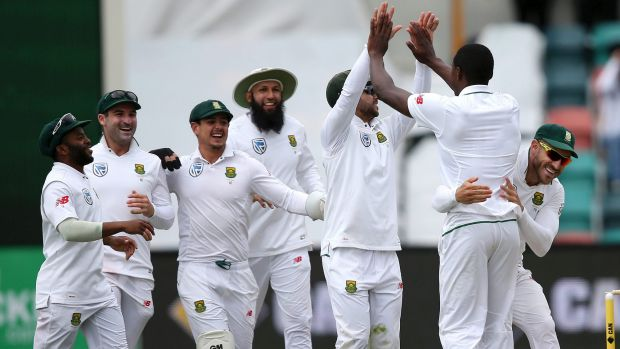The South Africans celebrate with Kagiso Rabada, after he took Callum Ferguson's wicket on day four.