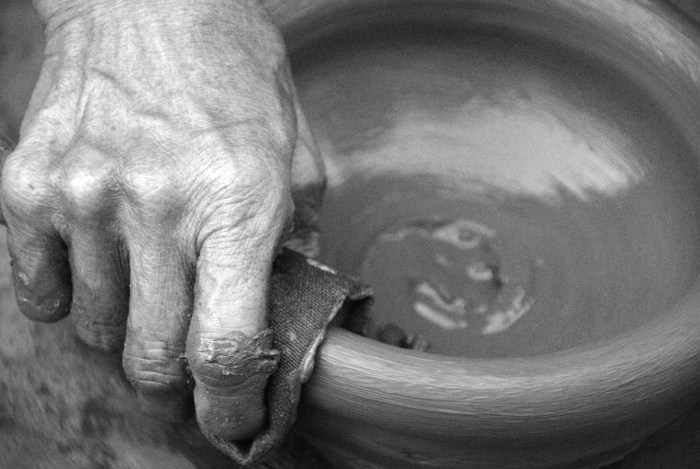 A pot is being molded by a skillful hand. Photo by: Dax Simbol