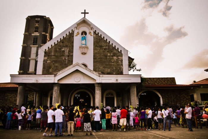 Churchgoers hear mass on Palm Sunday at the Immaculate Conception Parish Church in Los Baños, Laguna. Photo by: Kimmy Baraoidan