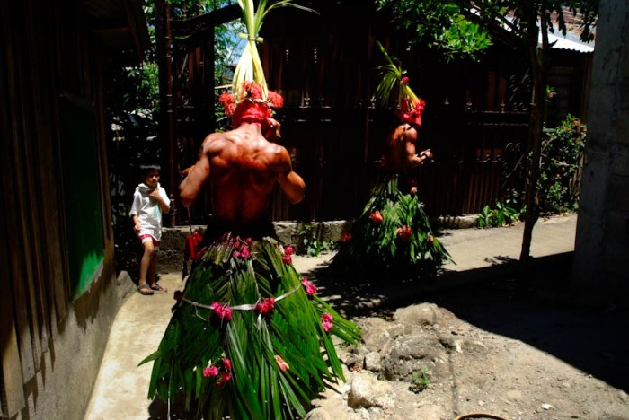 Flagellants in Kalayaan, Laguna wear traditional costumes made of palm leaves adorned with flowers. Photo by: Sonny Yabao