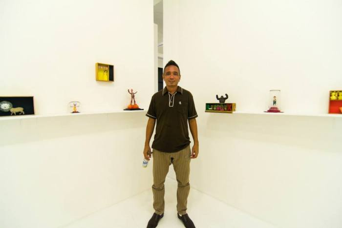 Mideo Cruz stands in the middle of his latest work exhibited at Blanc Gallery on Katipunan Ave., Quezon City. Photo courtesy of Blanc Gallery.